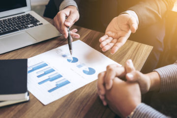Business people are working in office, presentation in front of boss, businessman leader presentation to her colleagues and business strategy and pointing to the graph and chart.